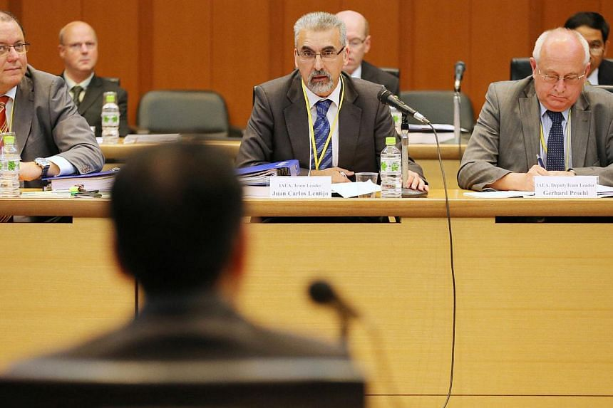 Juan Carlos Lentijo (centre), Director of Division of Nuclear Fuel Cycle and Waste Technology and mission leader of the International Atomic Energy Agency (IAEA), and his delegation members meet Japanese officials in Tokyo on Monday, Oct 14, 2013.&nb