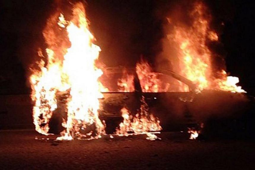 In a second accident to be reported along the Pan-Island Expressway in a day, a car burst into flames on the highway on Monday evening.-- PHOTO: STOMP