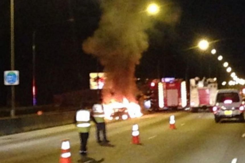 In a second accident to be reported along the Pan-Island Expressway in a day, a car burst into flames on the highway on Monday evening. -- PHOTO: STOMP
