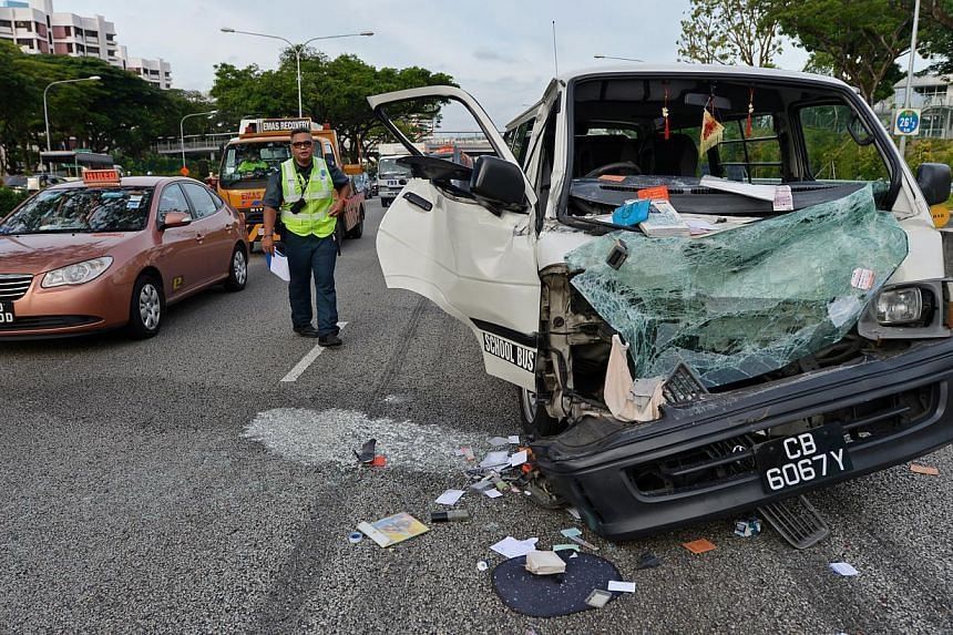 Two men sustained minor injuries in an accident involving a van and a mini-bus along the Pan-Island Expressway (PIE) on Monday afternoon. -- ST PHOTO:CAROLINE CHIA