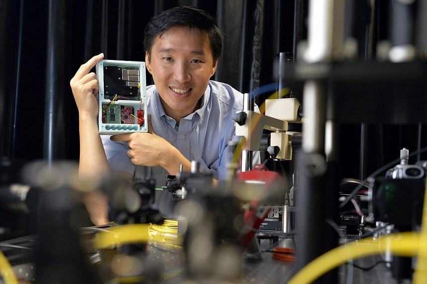 Dr Alexander Ling with the quantum entanglement  device he and his team developed. He is in talks with the National University of Singapore and European space conglomerate QB50 to piggyback their space missions and launch his experiment.
