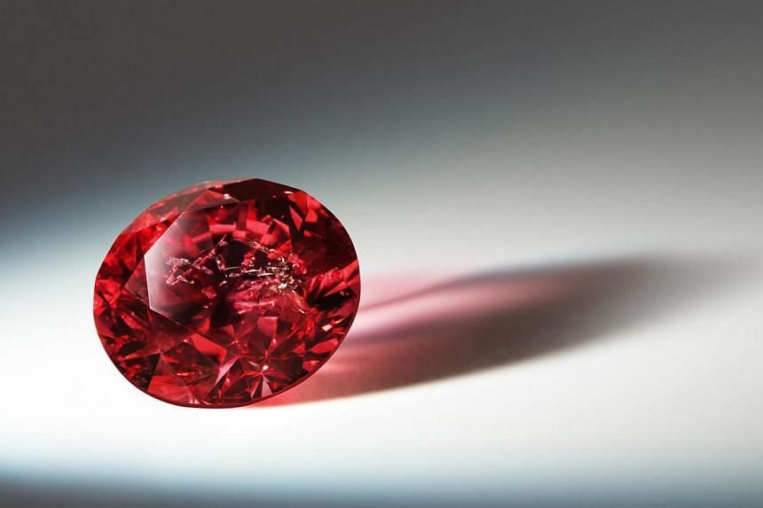 A handout photo received from Rio Tinto on Oct 14, 2013 shows the Argyle Phoenix, a 1.56 carat gem, one of three Fancy Red diamonds on offer which sold for more than USD 2 million to a Singapore-based jeweller, fetching the highest per carat price fo