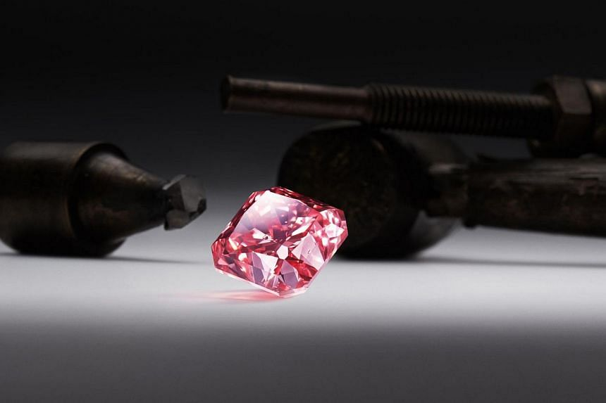 A handout photo received on Oct 14, 2013 shows the Argyle Dauphine, a 2.51 carat radiant cut diamond from the 2013 Argyle Pink Diamonds Tender collection that broke the record for the highest price paid for an Argyle diamond in overall value terms. -