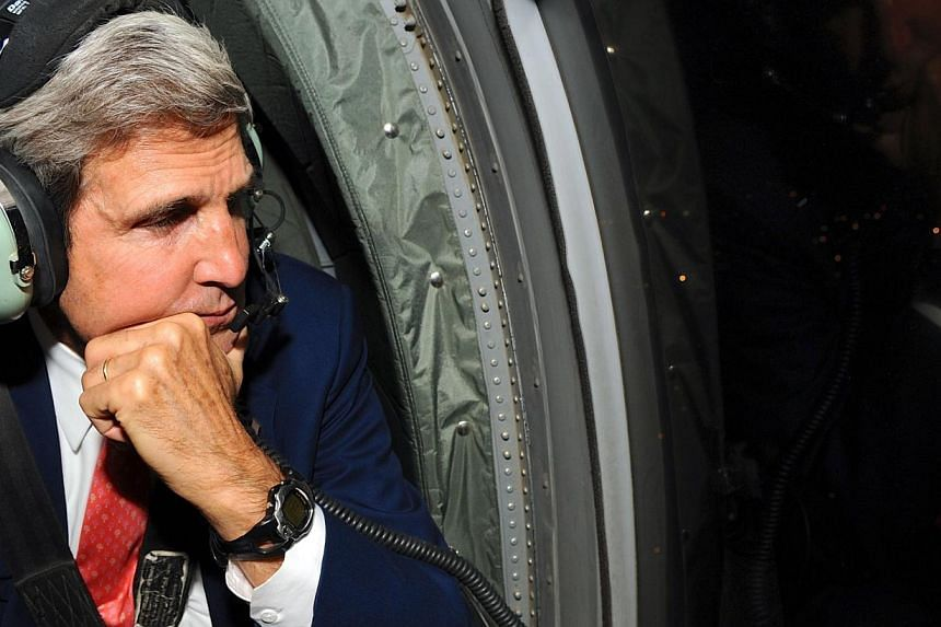 In this US State Department handout photo shows US Secretary of State John Kerry looking out of the window of an Army helicopter as he flies over Kabul following a two-day visit to Afghanistan that ended on Oct 12, 2013. United States Secretary of St
