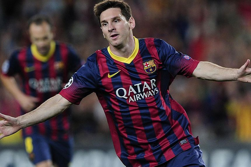 Barcelona's Argentinian forward Lionel Messi celebrates after scoring during the UEFA Champions league football match FC Barcelona vs Ajax Amsterdam at Camp Nou stadium in Barcelona on September 18, 2013. -- FILE PHOTO: AFP