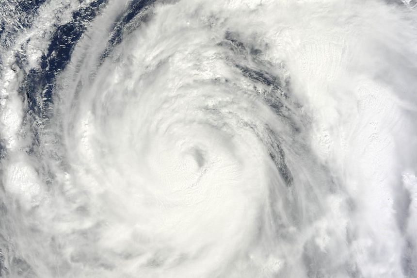 This Oct 13, 2013 NASA satellite image shows Typhoon Wipha in the Pacific Ocean.A powerful typhoon was closing in on Japan on Tuesday, on a path that will take it towards the precarious Fukushima nuclear power plant. -- FILE PHOTO: AFP