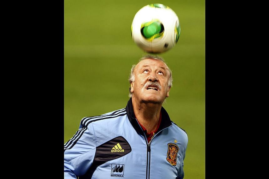 Spain's coach Vicente del Bosque heads the ball during a training session at the Carlos del Monte stadium in Albacete on October 14, 2013 on the eve of their World Cup 2014 qualifying football match Georgia vs Spain.Spain coach Vicente del Bosq