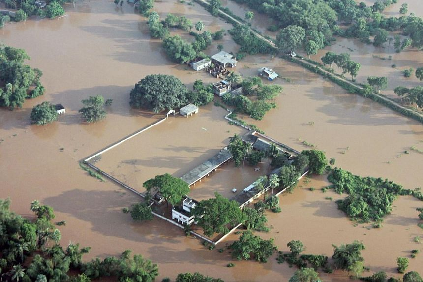 This handout photograph released by the Ministry of Defence shows a flooded area near Balasore following Cyclone Phailin on Monday, Oct 14, 2013. Cyclone-induced flooding has killed five people in eastern India, a government official told AFP on
