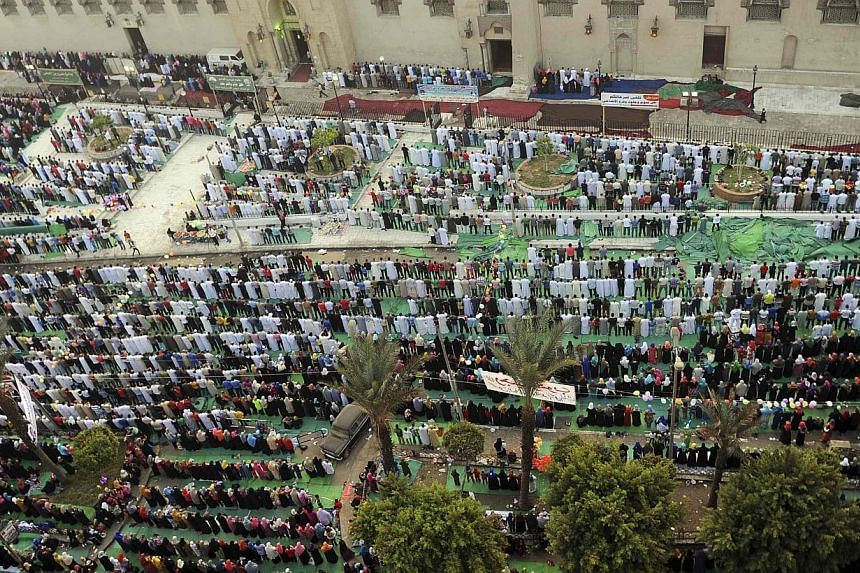 Muslims pray during Eid al-Adha at Amr Ibn El-Aas mosque in Cairo on Tuesday, Oct 15, 2013.Muslims across Egypt offered prayers at local mosques early on Tuesday to mark Eid al-Adha, as security forces shut down key public squares that have see