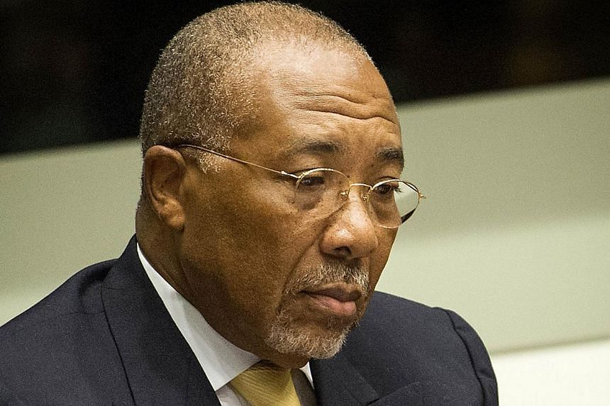 Liberia's ex-warlord Charles Taylor (above) was on Tuesday, Oct 15, 2013, transferred from The Hague to a British prison to serve his 50-year sentence for war crimes, the Special Court for Sierra Leone said. -- FILE PHOTO: AFP