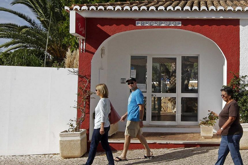 Tourists walk past the reception entrance to the Ocean Club holiday resort, where Madeleine McCann disappeared in 2007, in Praia da Luz, Southern Portugal on Monday, Oct 14, 2013. -- PHOTO: REUTERS