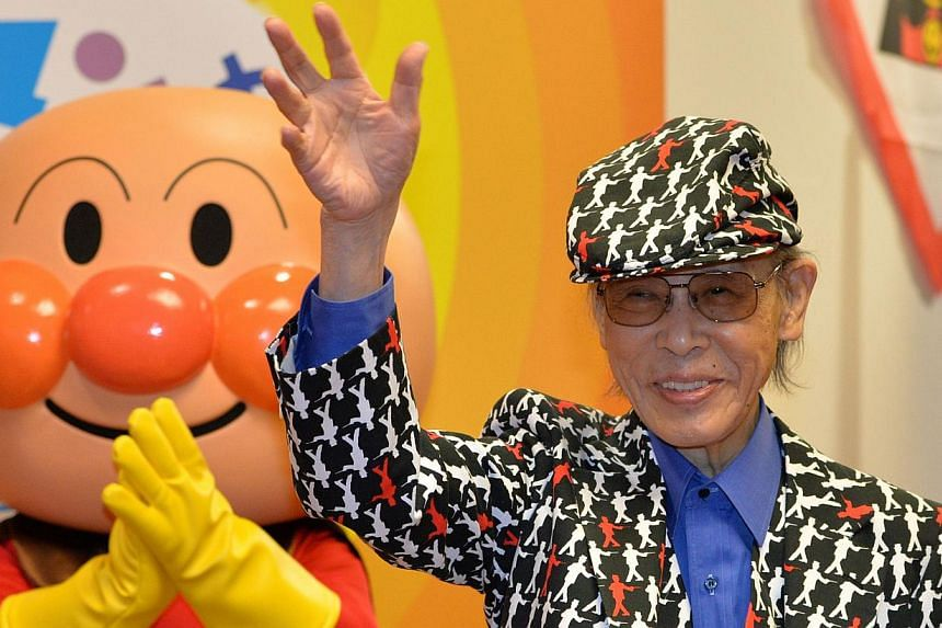 Japanese cartoonist Takashi Yanase (right)and his famous character Anpanman at his exhibition in Tokyo on May 1, 2013. Mr Takashi Yanase has died of heart failure, his agency said on Tuesday, Oct 15, 2013. -- FILE PHOTO: AFP