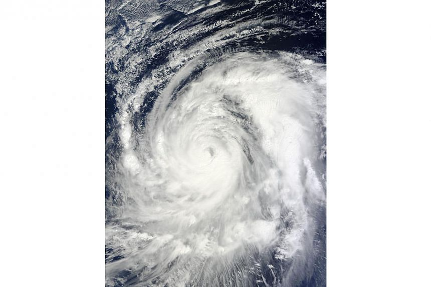 This Oct 13, 2013, satellite image by Nasa shows Typhoon Wipha in the Pacific Ocean.A typhoon described as the strongest in 10 years was closing in on Japan on Tuesday, Oct 15, 2013, on a path that will take it towards the precarious Fukushima