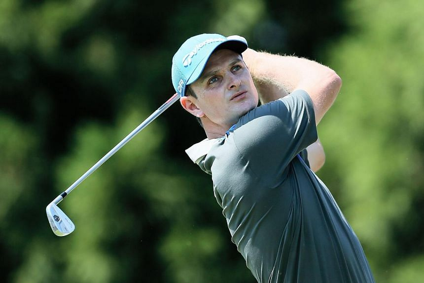 Justin Rose of England watches his tee shot on the second hole during the first round of the TOUR Championship by Coca-Cola at East Lake Golf Club on Sept 19, 2013 in Atlanta, Georgia. United States Open champion Rose fired a four-under par 67 o