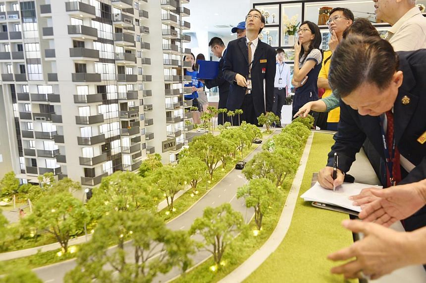Home buyers in Singapore picked up 1,246 private homes last month, as developers rolled out a range of new property launches. The top seller in September was Sky Vue (showroom in picture) in Bishan, where 433 units were sold at a median price of $1,4