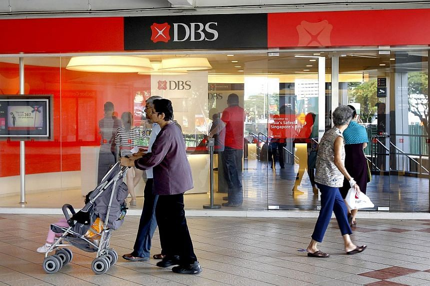 A number of DBS and POSB customers had difficulties using the bank's services at ATMs in some parts of Singapore around noon on Wednesday. -- ST PHOTO:CHEW SENG KIM