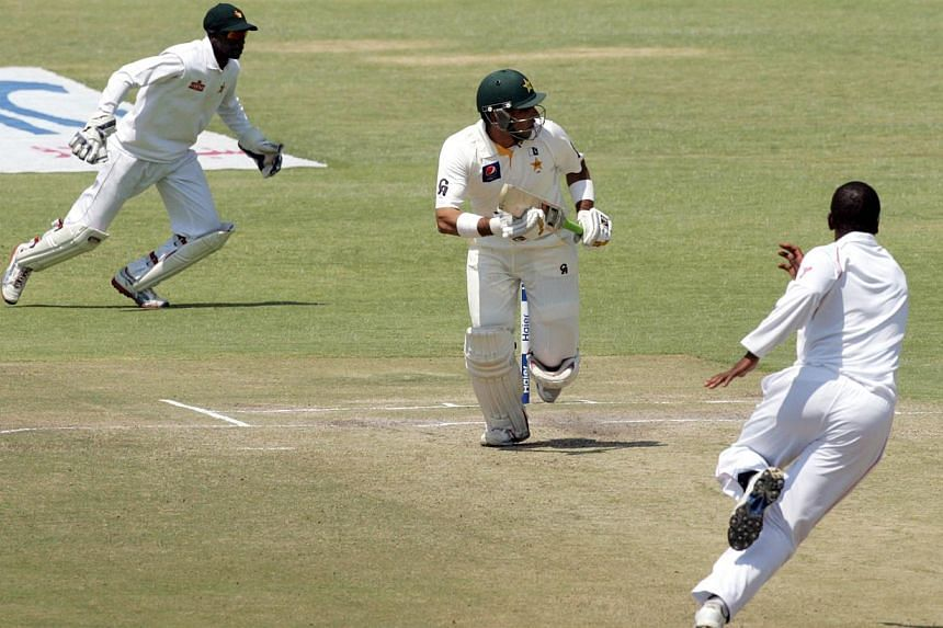 Pakistan's captain Misbah-ul-Haq (centre) runs on the fifth day of the second test match between Pakistan and Zimbabwe at the Harare Sports Club on Sept 14, 2013. Captain Misbah-ul-Haq showed the way with an unbeaten 78 as Pakistan pushed on to