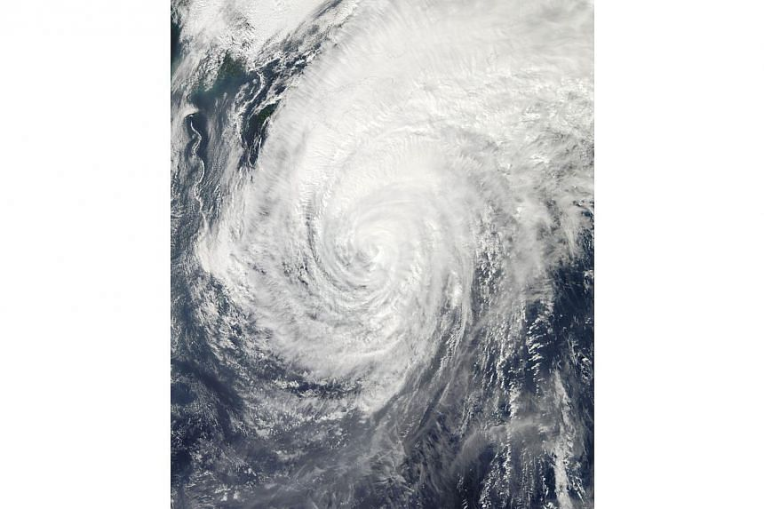 "This Oct 15, 2013 NASA satellite image shows Typhoon Wipha off Japan. At least three people died as Typhoon Wipha - the ""strongest in 10 years"" - passed close to Tokyo, causing landslides that swallowed houses on a Japanese island on Wednesday."