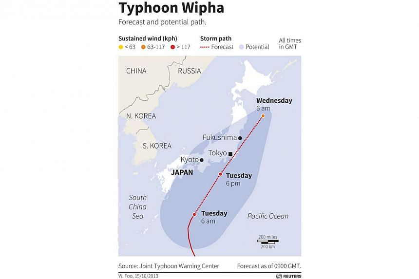 """Map tracking the forecast and potential path of Typhoon Wipha. At least three people died as Typhoon Wipha - the """"strongest in 10 years"""" - passed close to Tokyo, causing landslides that swallowed houses on a Japanese island on Wednesday.-- PHOT"""