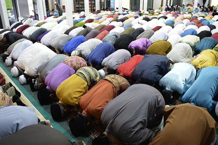 Muslims in prayer at the Darul Makmur Mosque in Yishun on Hari Raya Haji yesterday morning.