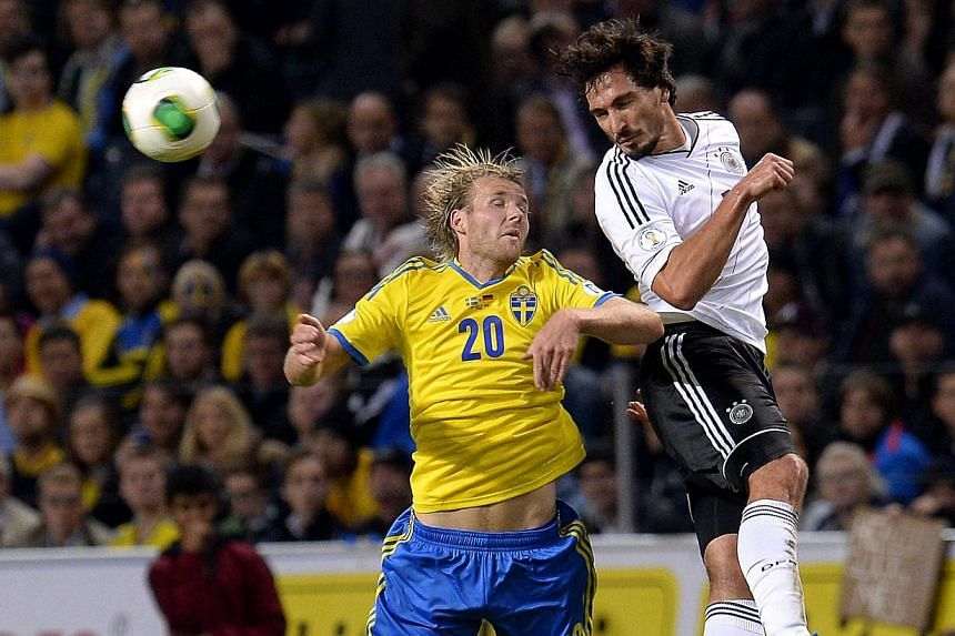 Sweden's forward Ola Toivonen and Germany's defender Mats Hummels vie for the ball during the Fifa 2014 World Cup group C qualifying football match Sweden v Germany in Solna, Sweden, on Oct 15, 2013. Germany beat Sweden 5-3. -- PHOTO: AFP