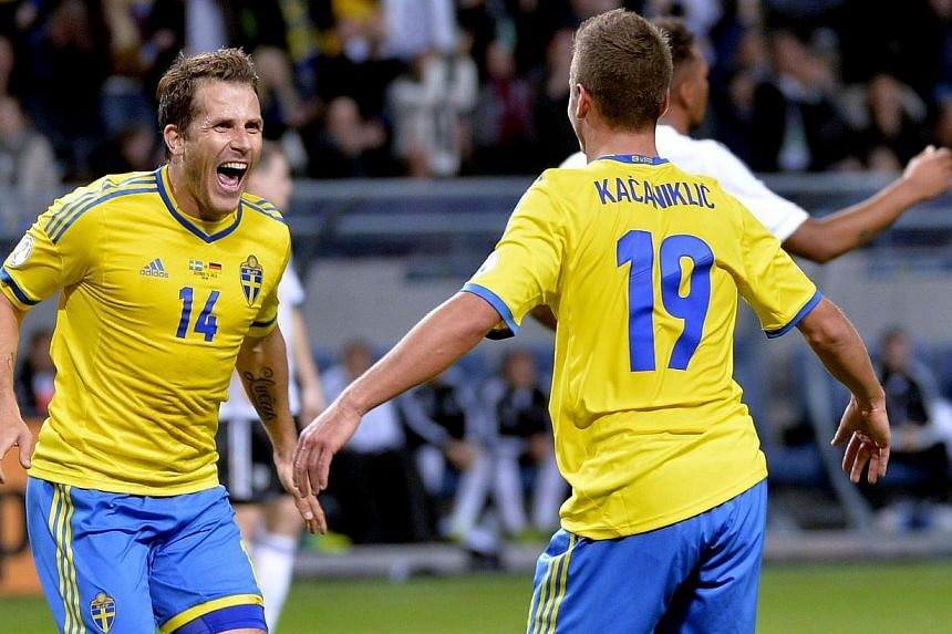 Sweden's Alexander Kacaniklic (19) celebrates his goal against Germany with teammate Tobias Hysen during their 2014 World Cup qualifying soccer match at Friends Arena in Stockholm on Oct 15, 2013. Germany beat Sweden 5-3. --PHOTO: REUTERS