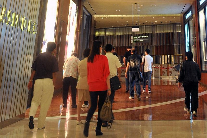 People walking outside the casino at Marina Bay Sands integrated resort on July 6, 2012.A Marina Bay Sands croupier has been caught by the police for allegedly cheating the casino. -- ST FILE PHOTO:KUA CHEE SIONG