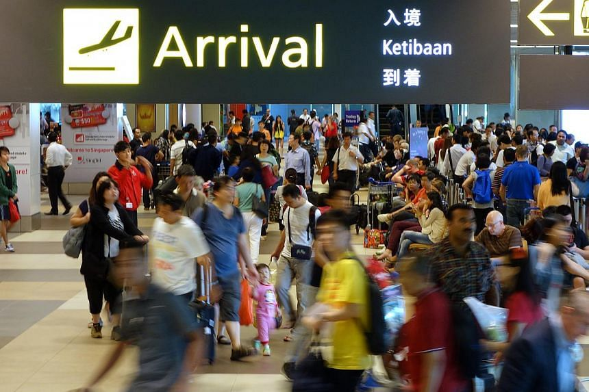 Travellers and tourists at the arrival hall of Changi Airport Terminal 1.A weak Indian rupee and a new tax imposed on television sets that are brought home from overseas have dampened the enthusiasm of Indian tourists to travel to Singapore. --