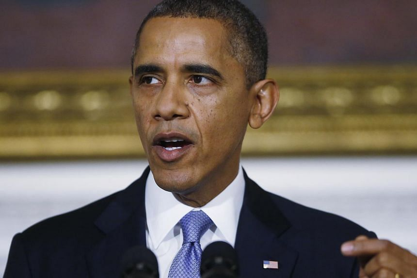 United States President Barack Obama speaks in the State Dining Room of the White House in Washington, on Thursday, Oct 17, 2013. Mr Obama warned on Thursday, Oct 17, 2013, that America's political dysfunction had encouraged its enemies and depressed