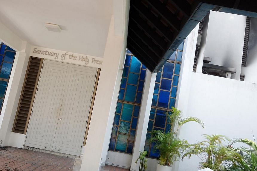 A fire broke out in the chapel at St Joseph's Institution (SJI) on Wednesday morning, but no one was hurt. -- ST PHOTO:JAMIE KOH