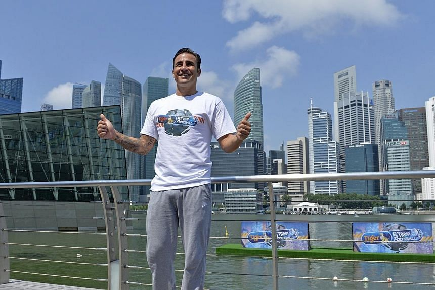 Italian World Cup winner Fabio Cannavaro poses for photographsat the pre-event press conference for this year's Tiger Street Football Singapore atthe Event Plaza@Marina Bay Sandson Thursday, Oct 17, 2013.His playing career too