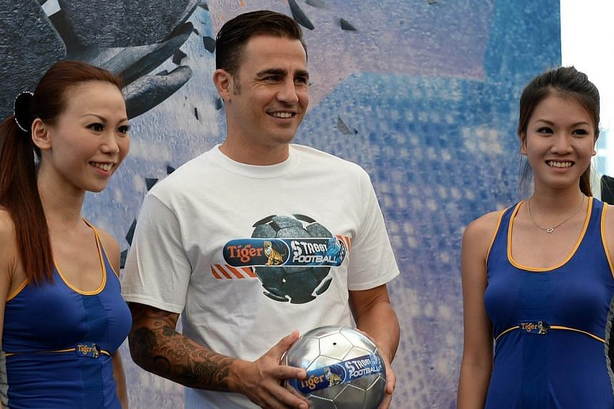 Italian World Cup winner Fabio Cannavaro poses for photographs at the pre-event press conference for this year's Tiger Street Football Singapore at the Event Plaza@Marina Bay Sands on Thursday, Oct 17, 2013. -- PHOTO: AFP