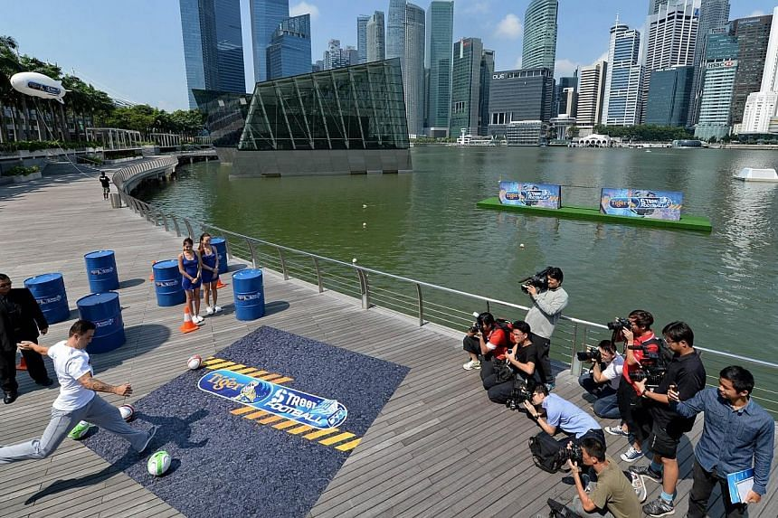 Italian World Cup winner Fabio Cannavaro displaying his skills at the pre-event press conference for this year's Tiger Street Football Singapore at the Event Plaza@Marina Bay Sands on Thursday, Oct 17, 2013. -- ST PHOTO: AFP