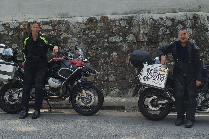 Clinical Associate Professor Philip Iau (right) and Associate Professor Mikael Hartman,from the National University of Singapore, will ride their motorcycles from Singapore to Sweden next March in the name of breast cancer research and educatio