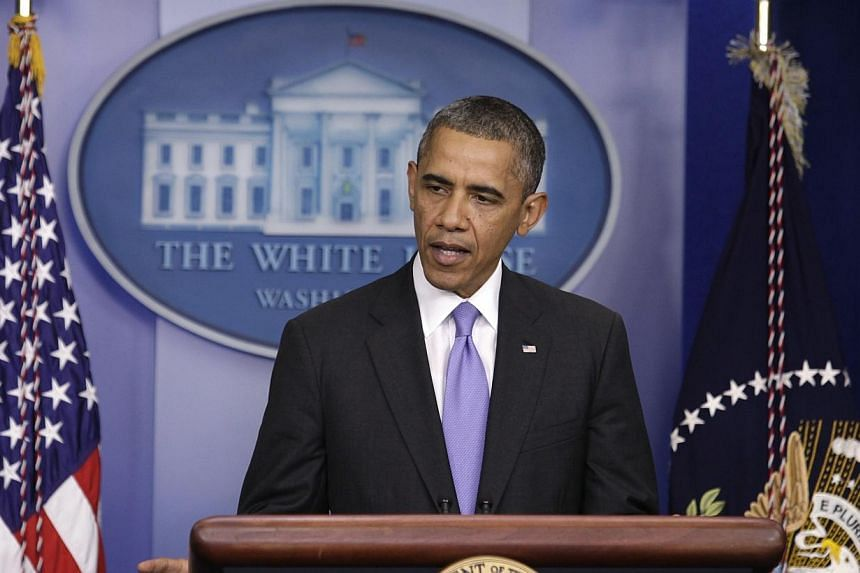 US President Barack Obama speaks to the media in the briefing room of the White House in Washington after the Senate passed the bill to reopen the government on Wednesday, Oct 16, 2013. MrObama signed early Thursday a bill ending the two-