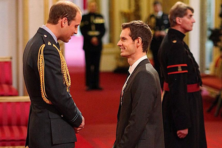 Wimbledon champion Andy Murray (right) receives his Order of the British Empire (OBE) medal from the from Britain's Prince William, during an Investiture ceremony at Buckingham Palace, London on Thursday Oct 17, 2013. -- PHOTO: AP