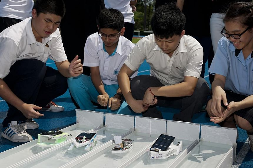 Secondary school students learn concepts like electric circuitry, buoyancy and propulsion through designing eco-friendly hybrid boats at Nanyang Polytechnic's Science & Technology Challenge held at Nanyang Polytechnic (NYP) on Thursday, Oct 17, 2