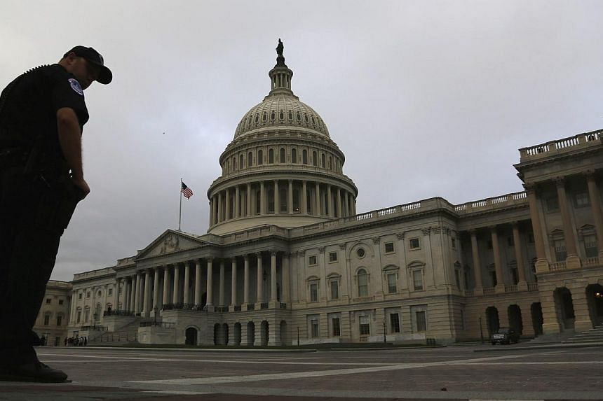 Overcast skies cover the US Capitol as lawmakers began their day in Washington, Oct 16, 2013.US Senate leaders announced a deal on Wednesday to end a political crisis that partially shut down the federal government and brought the world's bigge