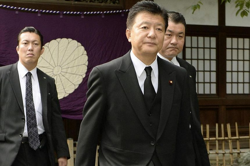 Japan's Internal Affairs and Communications Minister Yoshitaka Shindo leaves after visiting Yasukuni Shrine in Tokyo on Oct 18, 2013 in this picture provided by Kyodo. Mr Shindo visited the controversial Yasukuni Shrine on Friday, a move likely to an