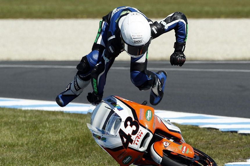 Kiefer Racing Moto3 rider Luca Grunwald of Germany crashes during a free practice session ahead of the Australian Motorcycle Grand Prix, at Phillip Island Circuit, Thursay, Oct 18, 2013. - PHOTO: REUTERS