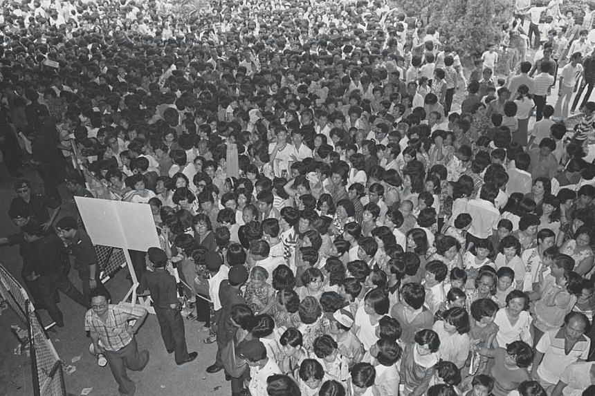 1980: A crowd of pilgrims at Clifford Pier awaiting their turn for a ferry ride to Kusu Island. The pier was closed on March 31, 2006. -- ST FILE PHOTO