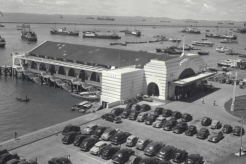 1950: A bird's eye view of Clifford Pier (above) and Kusu Island pilgrims returning from their annual trip, which takes place in the ninth lunar month. The number of pilgrims has been falling, with 47,000 people making the journey last year, compared