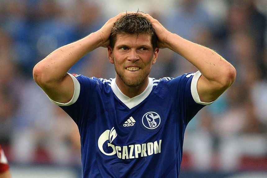 Dutch striker Klaas-Jan Huntelaar (above) will likely not return to action before January because of knee ligament damage, according to Schalke sporting director Horst Held. -- FILE PHOTO: AFP
