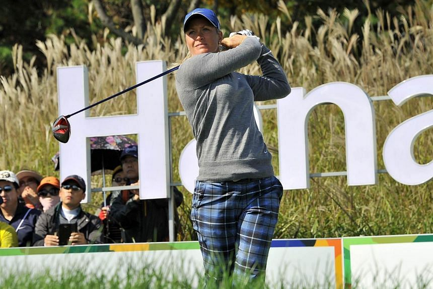Defending champion Suzann Pettersen of Norway tees off at the 9th hole during the first round of the LPGA KEB-HanaBank Championship golf event at the Sky72 Golf Club in Incheon, west of Seoul on Friday, Oct 18, 2013.Pettersen put herself in ear