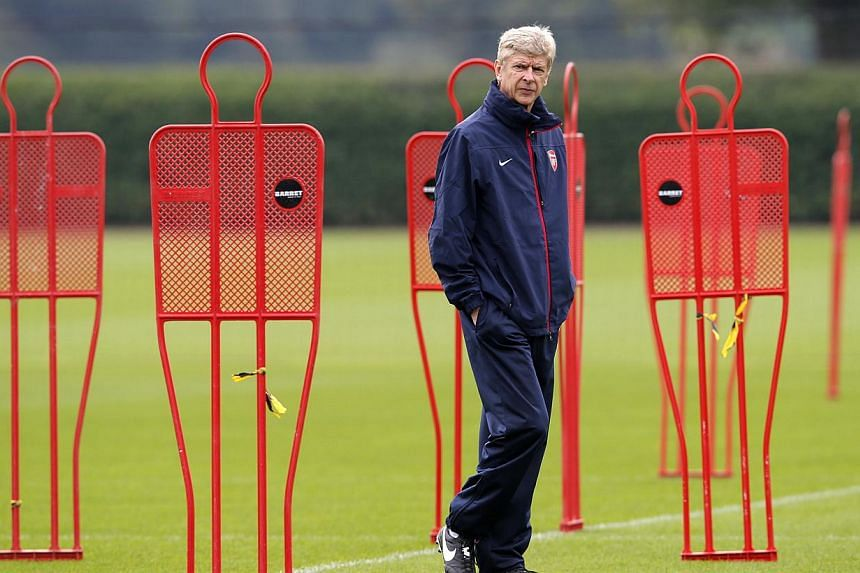 Arsenal manager Arsene Wenger attends a team training session at their training ground in London Colney Sept 30, 2013.Wenger on Friday insisted that he is in no hurry to sign a new contract with the English Premier League leaders. -- PHOTO: REU