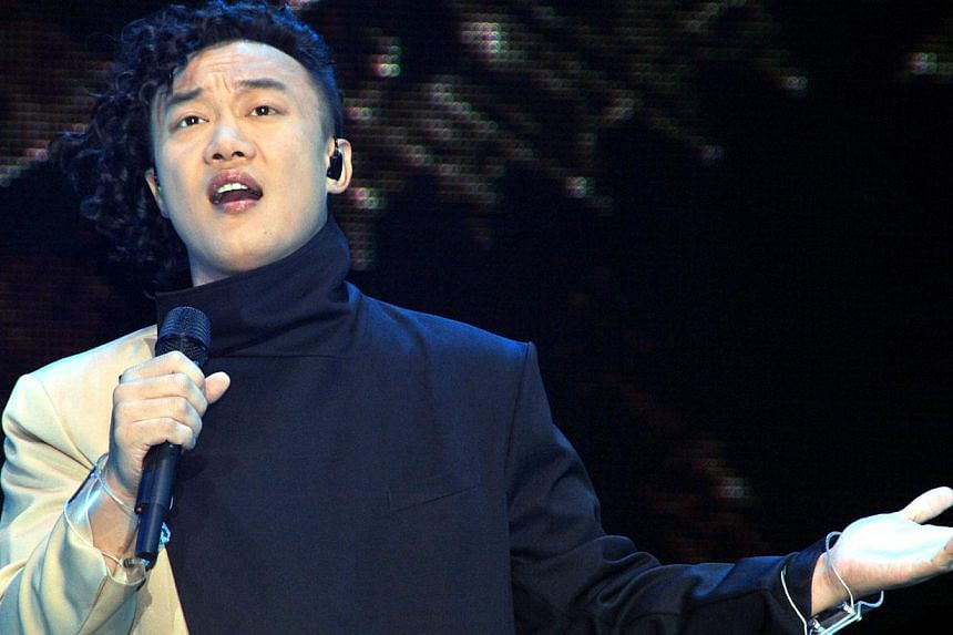 Hong Kong singer Eason Chan performing at the Singapore Indoor Stadium on 18 September 2010.In 2004, the popular singer had to issue an apology after using Cantonese on Cable TV. -- FILE PHOTO: SPH