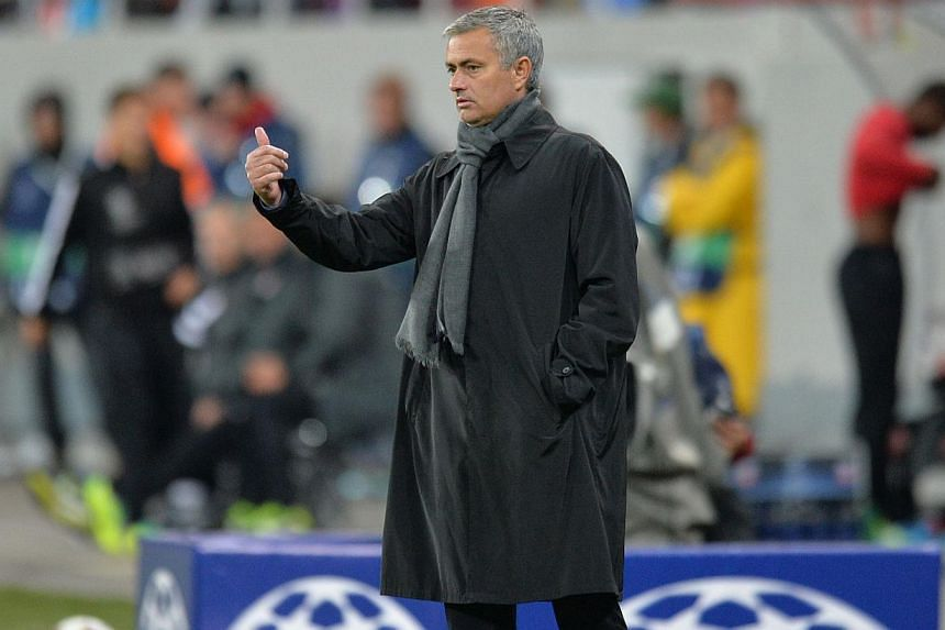 Chelsea's Portuguese manager Jose Mourinho gestures during the UEFA Champions League Group A football match Steaua Bucharest vs Chelsea FC at National Arena Stadium in Bucharest, Romania on Oct 1, 2013. Chelsea manager Jose Mourinho said on Thursday