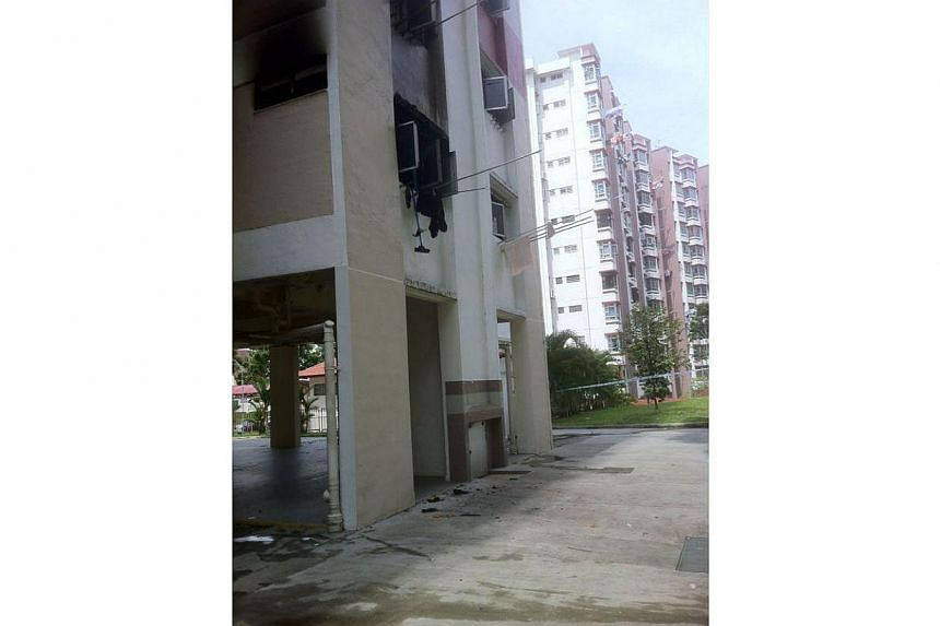 Four residents of an Ang Mo Kio flat narrowly escaped a fire that broke out in their second floor unit on Friday morning. -- PHOTO: SCDF