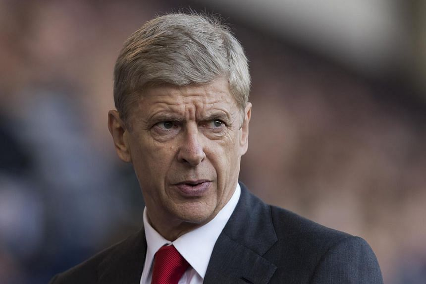 Arsenal's manager Arsene Wenger takes to the touchline before his team's English Premier League soccer match against West Bromwich Albion at The Hawthorns Stadium, West Bromwich, England, on Sunday, Oct 6, 2013.Wenger said on Thursday that his