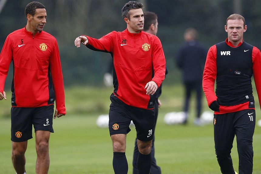 Manchester United's Wayne Rooney (right), Robin van Persie (centre) and Rio Ferdinand attend a training session at the Carrington training complex in Manchester, northern England, on Oct 1, 2013. Manchester United manager David Moyes has revealed sta
